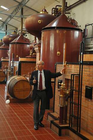Touring past distillery hardware at Hennessy. Photo: Bill Fink, Special To The Chronicle