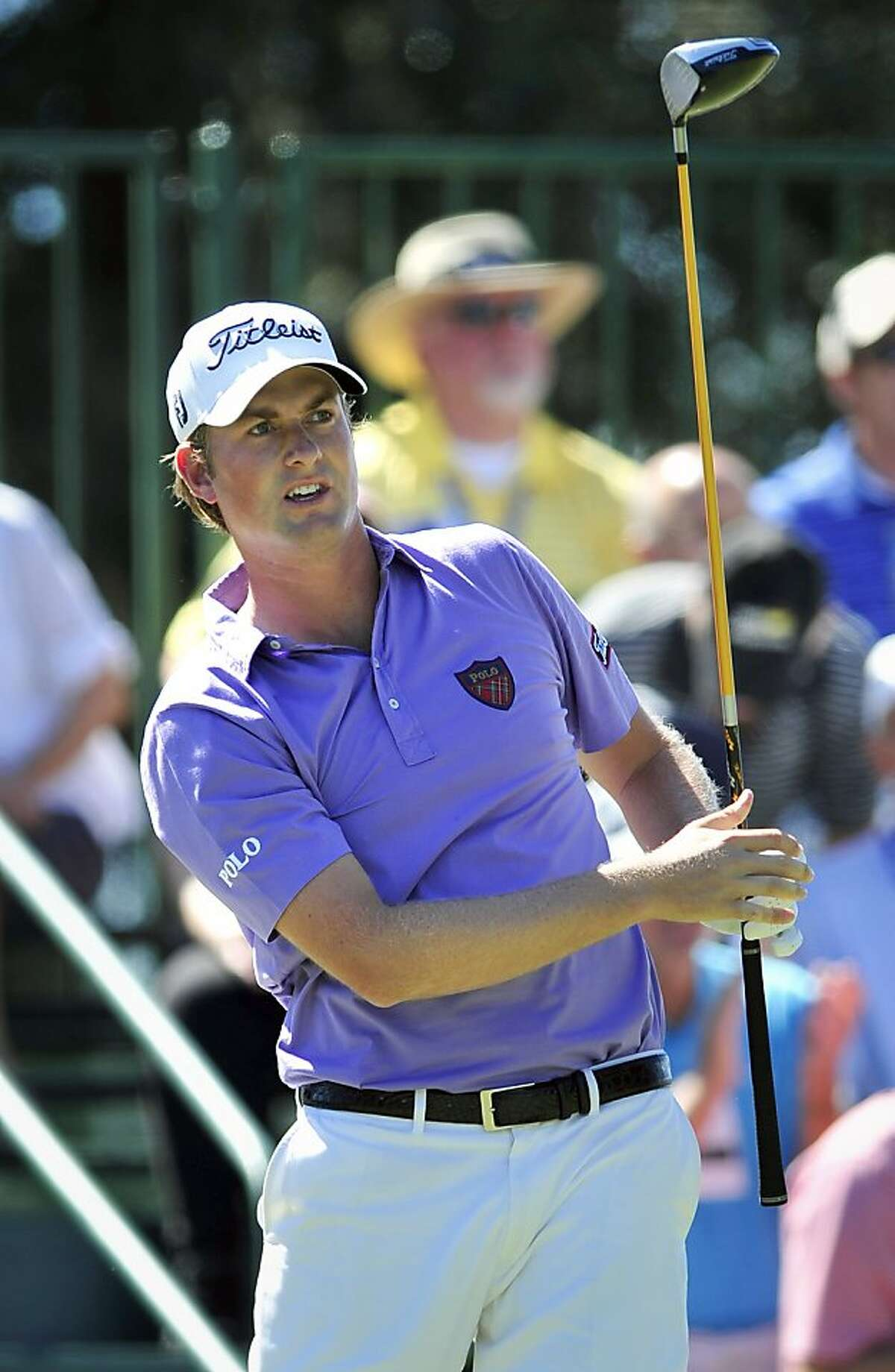 Webb Simpson watches his shot off the first tee during the final round of the McGladrey Classic golf tournament at the Sea Island Golf Club on St. Simons Island, Ga., Sunday, Oct. 16, 2011. (AP Photo/Stephen Morton)