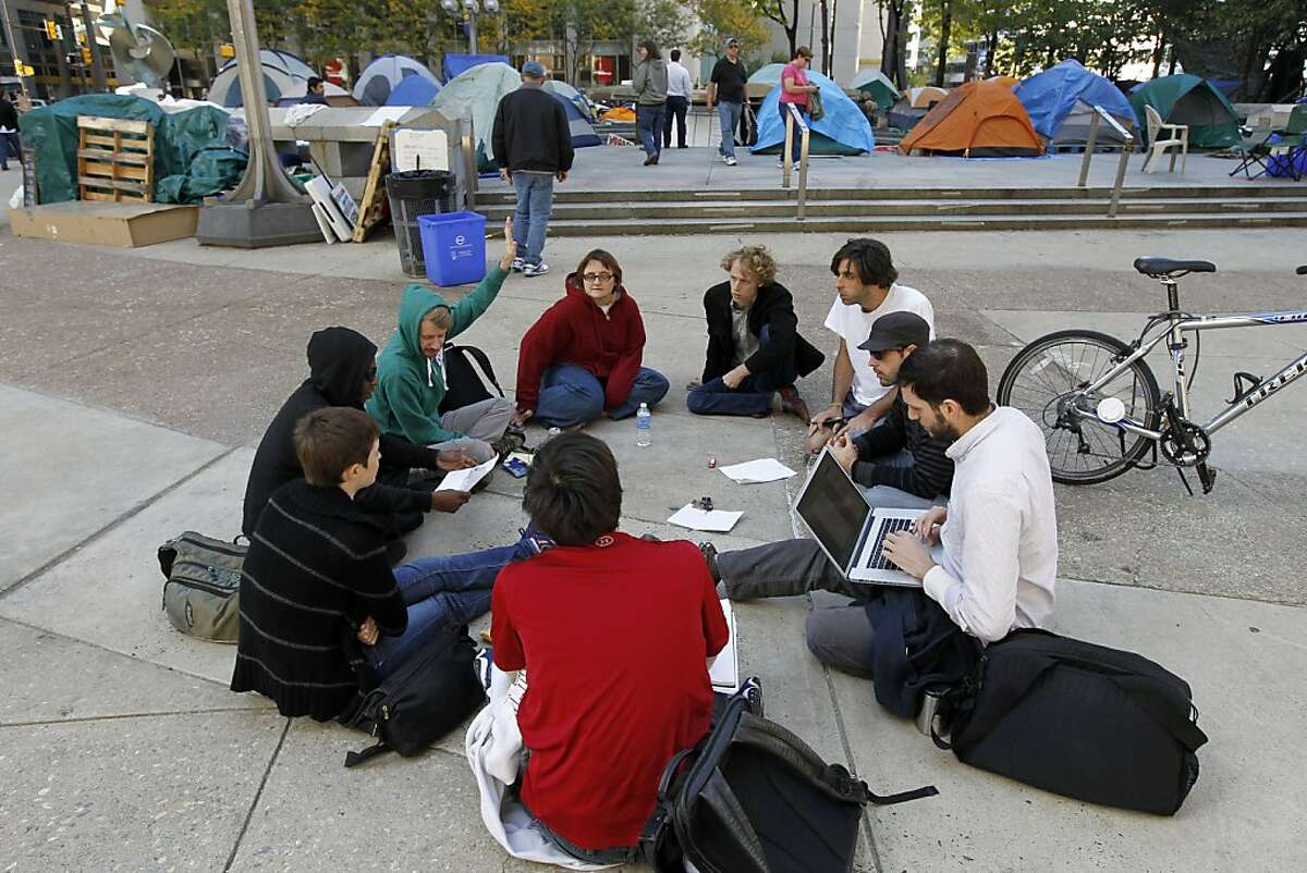 A group meets to discuss some of the issues that face the demonstration in the park around City Hall Sunday, Oct. 16, 2011 in Philadelphia. The demonstration at City Hall is one of many being held across the country in support of the ongoing Occupy Wall Street demonstration in New York. (AP Photo/Alex Brandon)