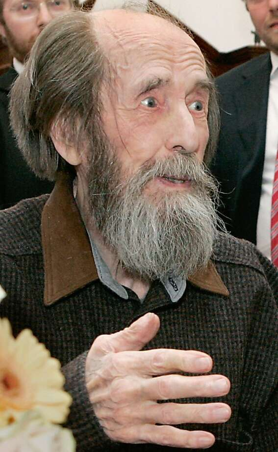 (FILES) A picture released 13 June 2007 shows Nobel laureate Alexander Solzhenitsyn listening to Russian President Vladimir Putin at his home in Troitse-Lykovo, outside Moscow, 12 June 2007, as Putin came to visit him, as Alexander Solzhenitsyn could not receive his State Prize during the ceremony in the Kremlin due to illness. Russian writer and dissident Alexander Solzhenitsyn died overnight Sunday to Monday, the Itar-Tass news agency said, citing his son Stepan on August 3, 2008. He was 89. Solzhenitsyn won the Nobel Prize for literature in 1970 after writing harrowing works about the Soviet Union's system of labour camps. He was expelled from the Soviet Union in 1974. Since his return to Russia in 1994 he has been critical of the West and of Russia's post-Soviet evolution, calling for a return to traditional moral values. Photo: Mikhail Klimentiev, AFP/Getty Images
