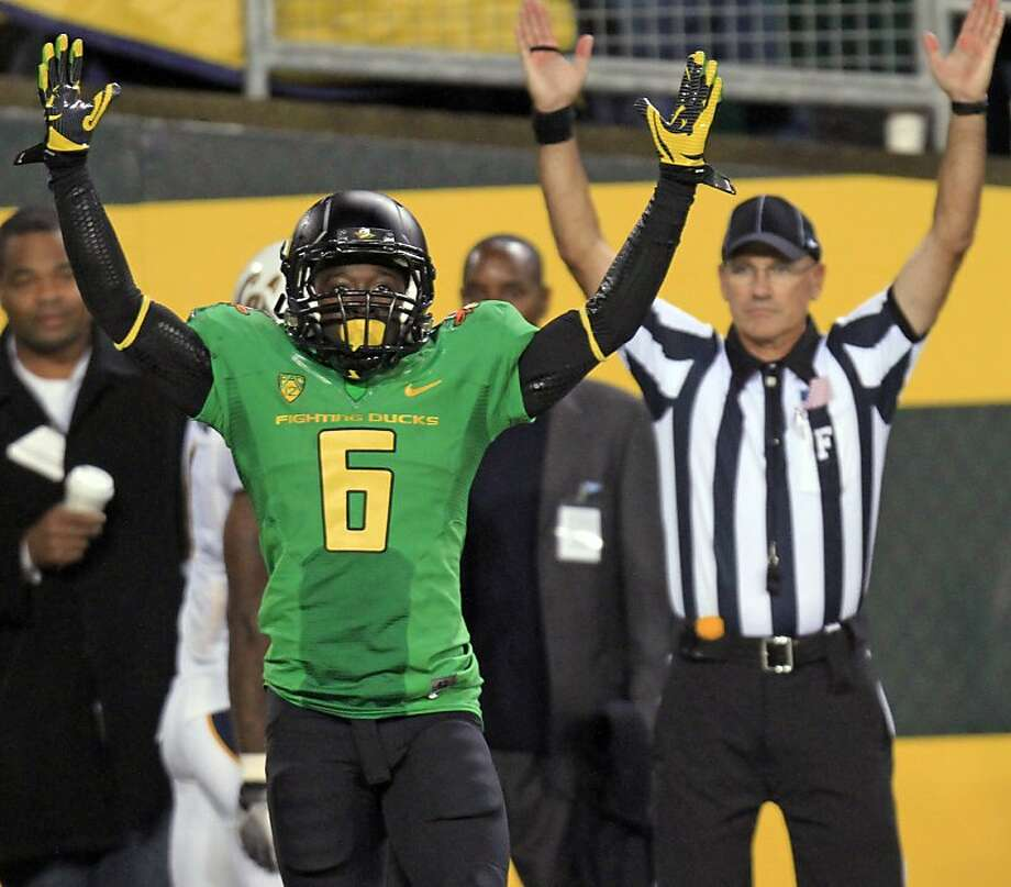 Oregon running back DeAnthony Thomas celebrates his touchdown reception during the second half of an NCAA college football game against California in Eugene, Ore.,  Thursday, Oct. 6, 2011. (AP Photo/Don Ryan) Photo: Don Ryan, AP