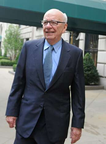 News Corporation head Rupert Murdoch exits his Fifth Avenue residence, Thursday, July 21, 2011, in New York. As the scandal runs its course in the U.K., Murdoch's News Corp. must confront at least two U.S.-based shareholder lawsuits, a possible Standard & Poor's credit downgrade, and the beginnings of a federal investigation. (AP Photo/Louis Lanzano)      Ran on: 08-11-2011 Rupert Murdoch's News Corp. lost income after the sale of social-networking site Myspace. Photo: Louis Lanzano, AP