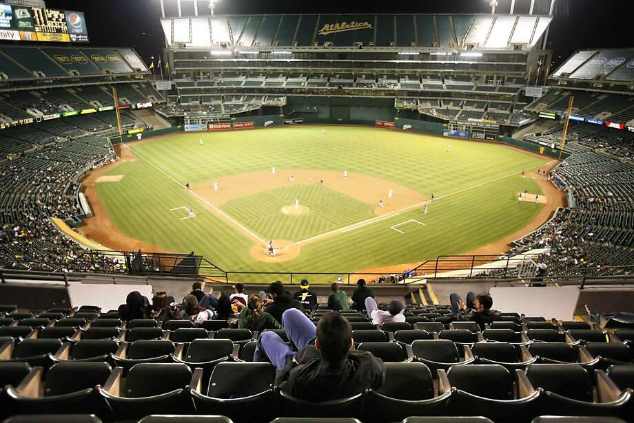 In years past, A's management reduced the size of the coliseum by placing tarps over the seats in the third level except for a small section behind home plate. The A's attendance is abysmal as illustrated by the lack of fans at the game against the Texas Rangers. The Oakland Athletics played the Texas Rangers at the Oakland-Alameda County Coliseum in Oakland, Calif., on Monday, May 3, 2010. The Rangers won 4-2.  Ran on: 05-30-2010 The A's struggle for attendance, and there will be no Bay Area games on Father's Day or July 4 weekends. Ran on: 05-30-2010 The A's struggle for attendance, and yet there will be no Bay Area games on the Father's Day or Fourth of July weekends. Ran on: 05-30-2010 The A's struggle for attendance, and yet there will be no Bay Area games on the Father's Day or Fourth of July weekends.  Ran on: 12-09-2010 The A's have tarped off the top portion of the stadium, but can't hide the fact no one comes to the games. Ran on: 12-09-2010 The A's have tarped off the top portion of the stadium, but can't hide the fact no one comes to the games. Ran on: 07-20-2011 Sharing a stadium with the Oakland A's has not worked well in recent years for the Raiders  --  or, for that matter, for the A's. Ran on: 07-20-2011 Sharing a stadium with the Oakland A's has not worked well in recent years for the Raiders  --  or, for that matter, for the A's. Photo: Carlos Avila Gonzalez, The Chronicle