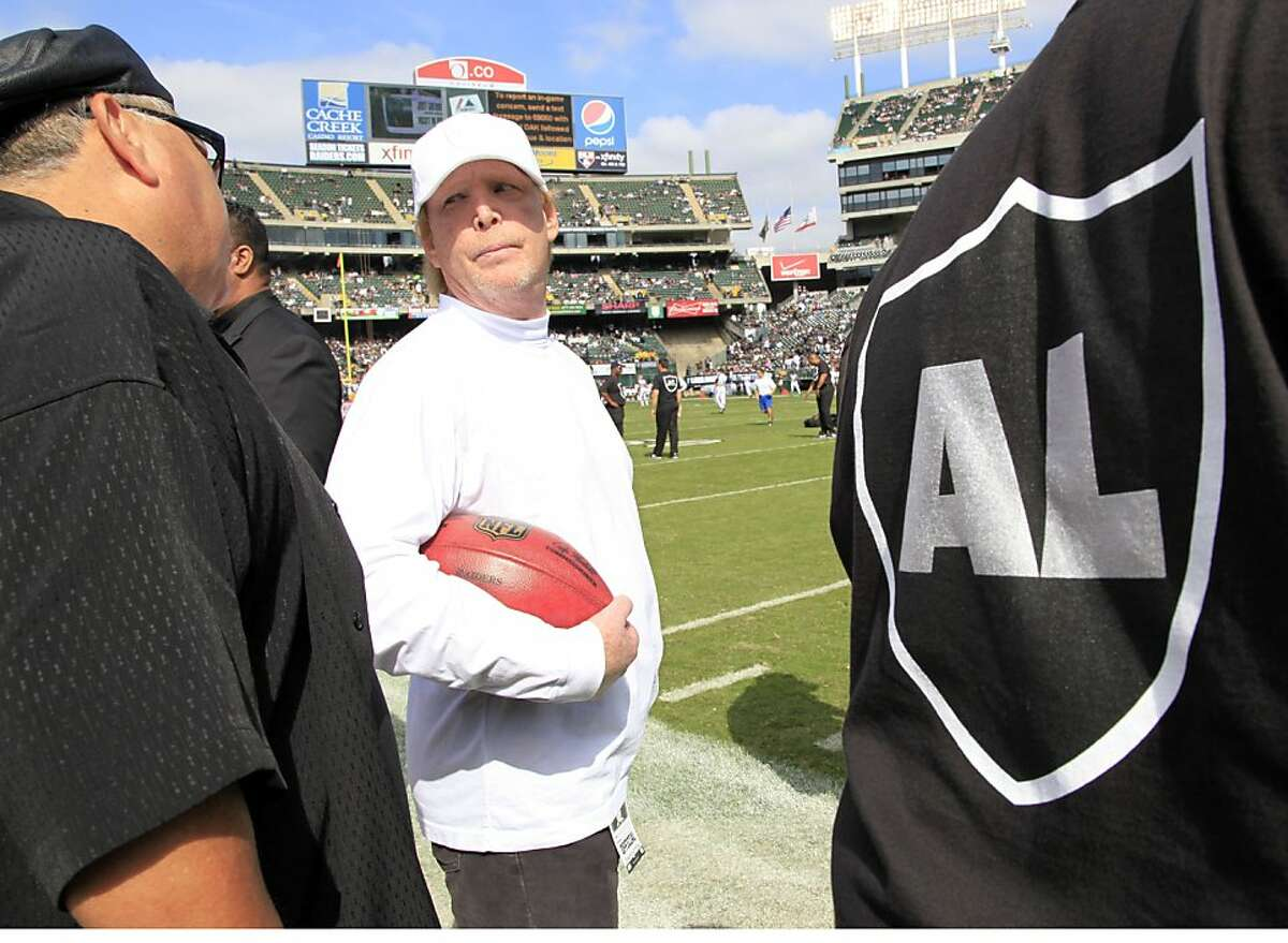 Mark Davis, the son of recently passed Oakland Raiders owner Al Davis, is greeted on the field before their NFL football game against the Cleveland Browns in Oakland, Calif., Sunday, Oct. 16, 2011. (AP Photo/Paul Sakuma)