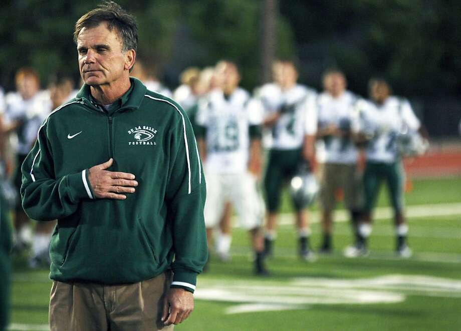 Bob Ladouceur head coach of De La Salle's nationally renowned football team stands with his players during the national anthem Friday October 7, 2011. Photo: Lance Iversen, The Chronicle