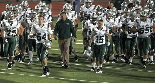 Bob Ladouceur head coach of De La Salle's nationally renowned football team walks off the field with his player leading comfortably over Foot Hill high school at the half Friday October 7, 2011. Photo: Lance Iversen, The Chronicle