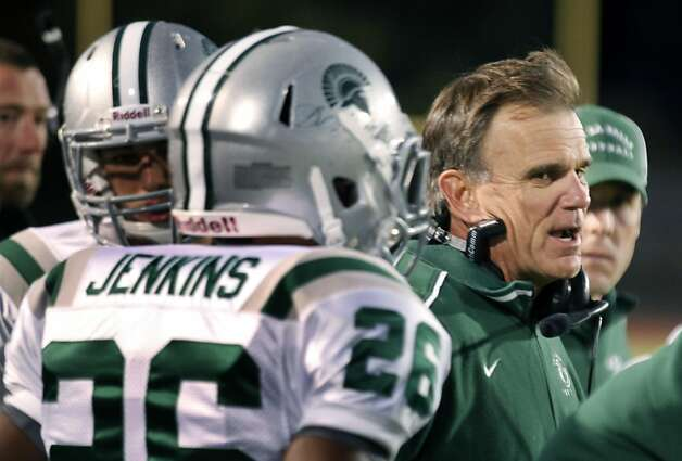 Bob Ladouceur head coach of De La Salle's nationally renowned football team sends out plays during their game with Foot Hill high school Friday October 7, 2011. Photo: Lance Iversen, The Chronicle