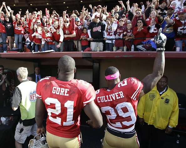 San Francisco 49ers running back Frank Gore (21) and San Francisco 49ers defensive back Chris Culliver (29) after an NFL football game in San Francisco, Sunday, Oct. 9, 2011. The San Francisco 49ers defeated the Tampa Bay Buccaneers 48-3. (AP Photo/Paul Sakuma) Photo: Paul Sakuma, AP