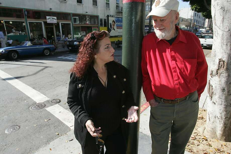 Former San Francisco Supervisor Angela Alioto and poet Lawrence Ferlinghetti talk about the plans for Piazza St. Francis which will be on the block directly behind them at Columbus and Grant Streets. Photo: Mathew Sumner, Special To The Chronicle