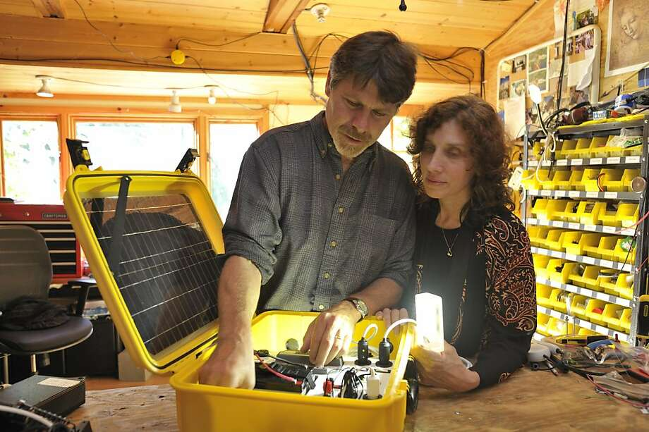 "Laura Stachel and her husband Hal were named laureates for this month's Tech Awards in San Jose, which recognizes the use of technology to benefit humanity. They created a ""solar suitcase"" that allows for emergency power and light for medical procedures in third world countries. The design the machines at the workshop at their home in Berkeley. Photo: David Butow"