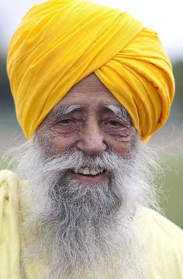 Centenarian Fauja Singh smiles on the track between races in Toronto, Thursday Oct. 13, 2011. One-hundred-year-old Singh, originally from India now living in London,  England,  is competing in Toronto's Waterfront Marathon on Sunday.  (AP Photo/The Canadian Press, Chris Young) Photo: Chris Young, AP