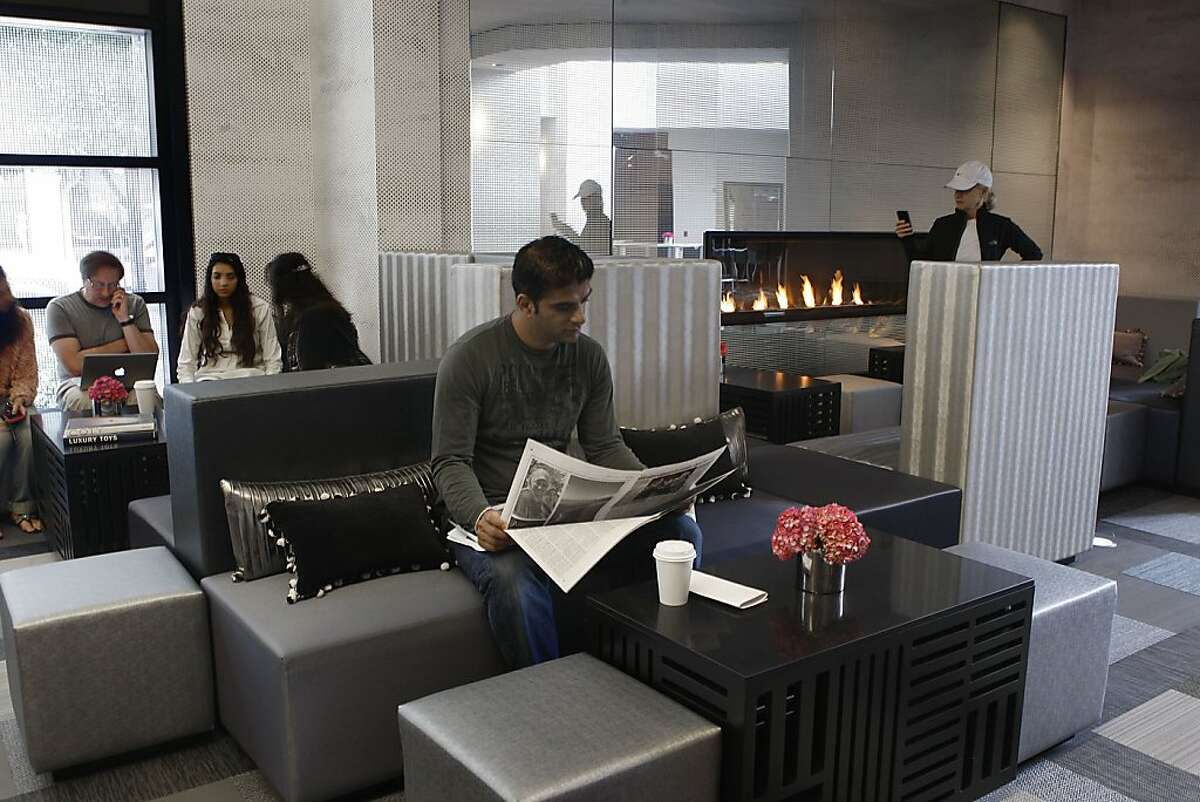 W San Francisco is unveiling it's new look on October 19th in San Francisco, California, as Rick Sidhu from Vancouver reads the paper in the living room area on Monday, October 10, 2011.