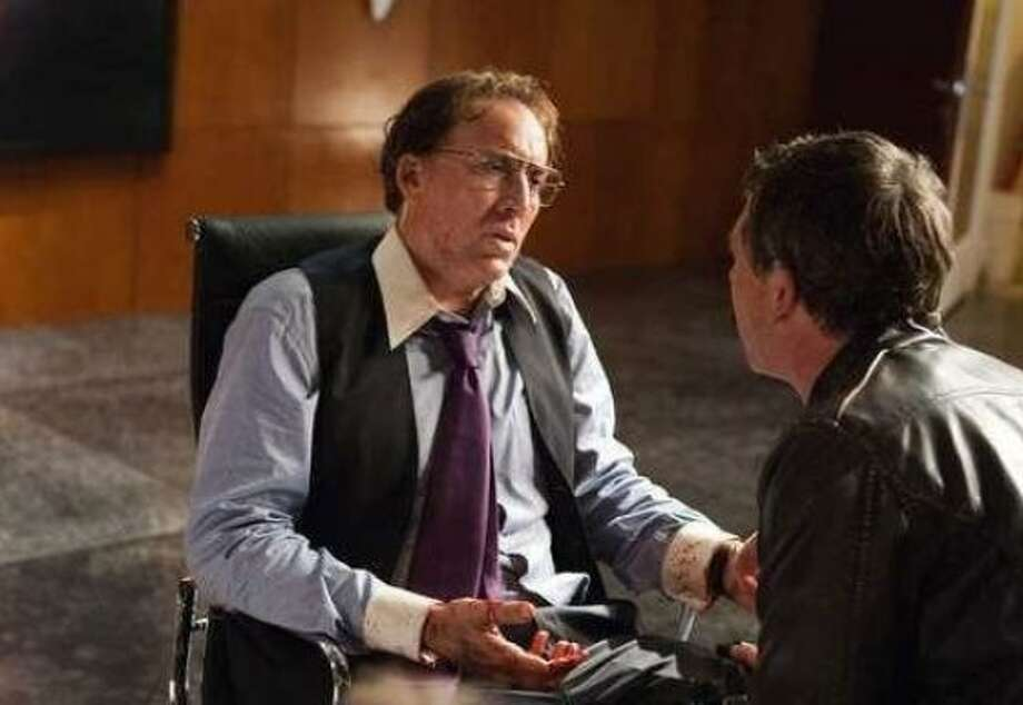 "Nicolas Cage in ""Trespass."" Other actor is unidentified. Photo: Millennium Films, Cinemarx.ro"
