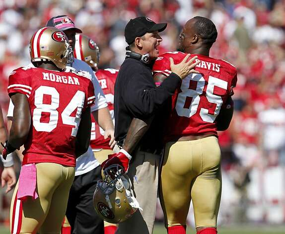 San Francisco 49ers head coach Jim Harbaugh congratulates Vernon Davis after he scores in the second quarter against the Tampa Bay Buccaneers, Sunday Oct. 9, 2011, at Candlestick Park in San Francisco, Calif. The 49ers defeated the Buccaneers 48 to 3. Photo: Lacy Atkins, The Chronicle