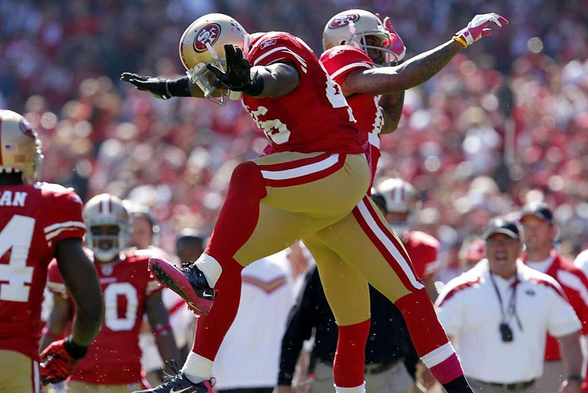 San Francisco 49ers Delanie Walker celebrates with Vernon Davis after Walker caught a touchdown pass in the first quarter against the Tampa Bay Buccaneers, Sunday Oct. 9, 2011, at Candlestick PArk in San Francisco, Calif. The 49ers defeated the Buccaneers 48 to 3.