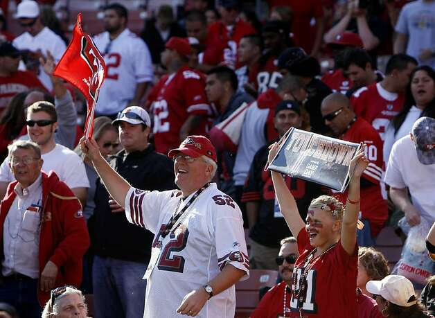 San Francisco 49ers fans Mike Martin and his daughter Hannah, 12 cheer as the 49ers  defeat the Tampa Bay Buccaneers, 48 to 3, Sunday Oct. 9, 2011, at Candlestick Park in San Francisco, Calif. Photo: Lacy Atkins, The Chronicle
