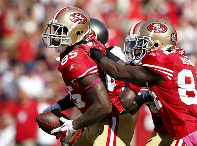 San Francisco 49ers Vernon Davis celebrates with  his team after scoring against the  Tampa Bay Buccaneers, Sunday Oct. 9, 2011, at Candlestick PArk in San Francisco, Calif. Photo: Lacy Atkins, The Chronicle