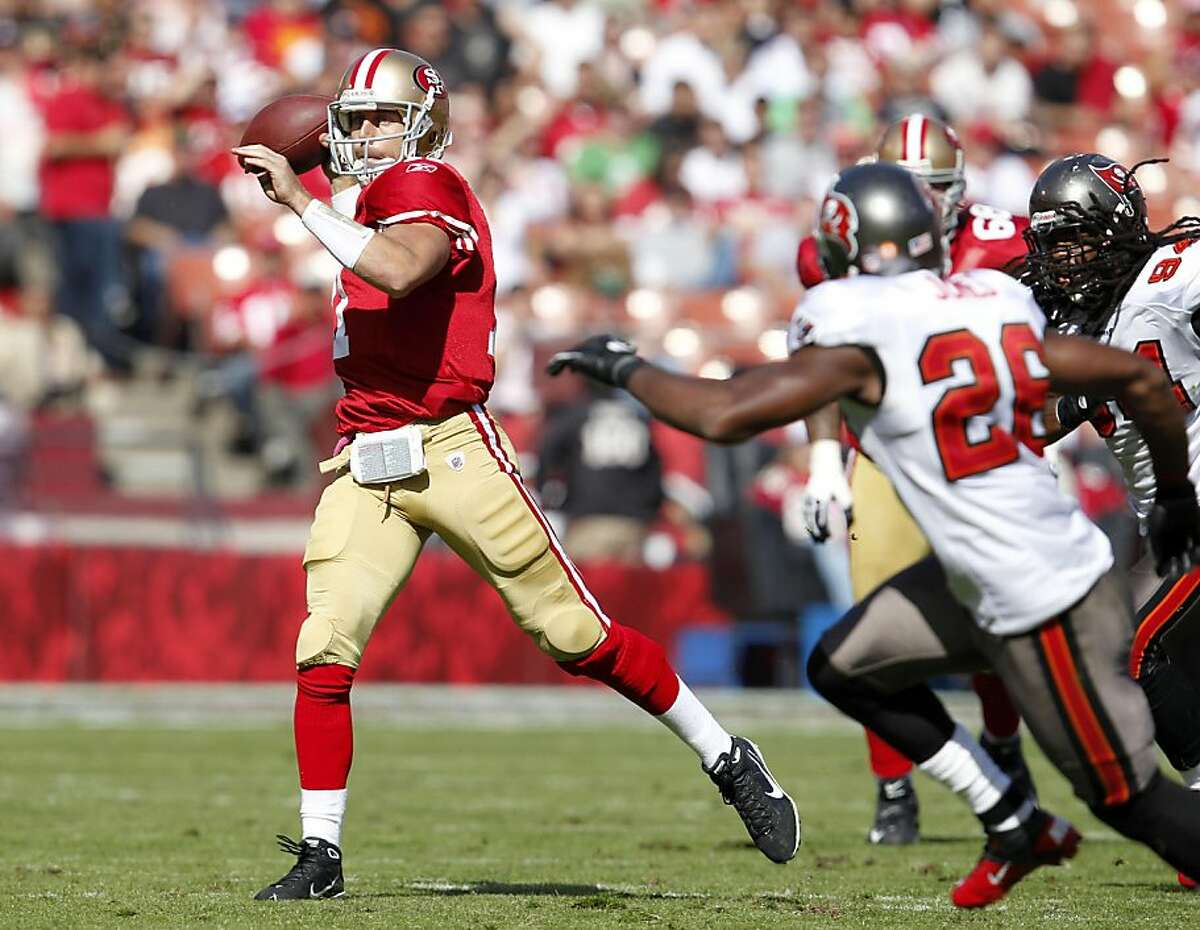 San Francisco 49ers quarterback Alex Smith throws the ball for a first down against theTampa Bay Buccaneers, Sunday Oct. 9, 2011, at Candlestick Park in San Francisco, Calif. The 49ers defeated the Buccaneers 48 to 3.
