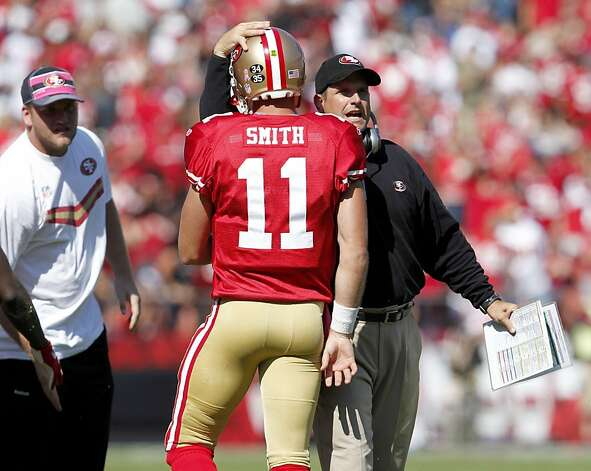 San Francisco 49ers head coach Jim Harbuagh congratulates quarterback Alex Smith in the game against theTampa Bay Buccaneers,  Sunday Oct. 9, 2011, at Candlestick Park in San Francisco, Calif. The 49ers now have a 4-1 record. Photo: Lacy Atkins, The Chronicle