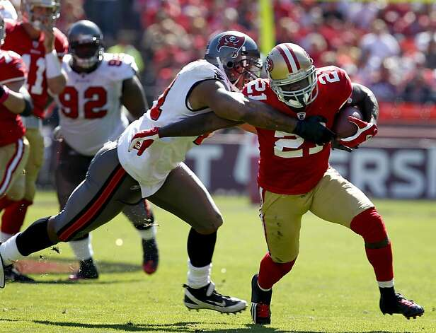 San Francisco 49ers Frank Gore is breaks through Tampa Bay Buccaneers Michael Bennett for a first down in the first quarter,  Sunday Oct. 9, 2011, at Candlestick PArk in San Francisco, Calif. Photo: Lacy Atkins, The Chronicle