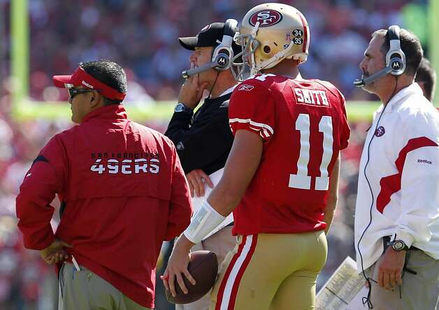 San Francisco 49ers head coach Jim Harbuagh contemplates the next play with quarterback Alex Smith in the game against theTampa Bay Buccaneers,  Sunday Oct. 9, 2011, at Candlestick Park in San Francisco, Calif. The 49ers now have a 4-1 record. Photo: Lacy Atkins, The Chronicle