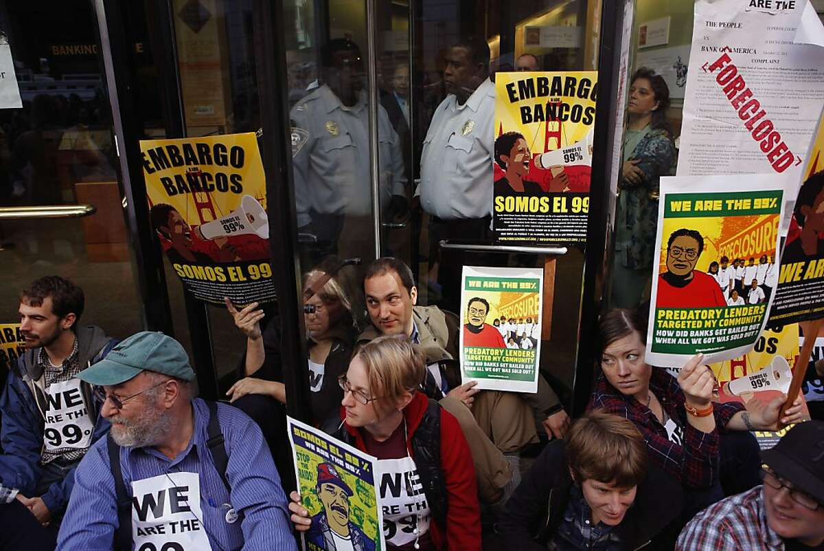 Protesters fill the revolving door on the Montgomery Street side, as they continued the Occupy Wall Street campaign blocking the entrances into the headquarters of Wells Fargo Bank in the financial district of San Francisco, Ca., on Wednesday October 12, 2011.