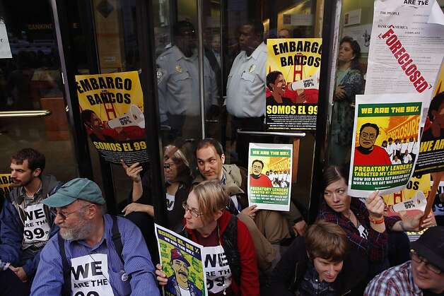 Protesters fill the revolving door on the Montgomery Street side, as they continued the Occupy Wall Street campaign blocking the entrances into the headquarters of Wells Fargo Bank in the financial district of San Francisco, Ca., on Wednesday October 12, 2011. Photo: Michael Macor, The Chronicle