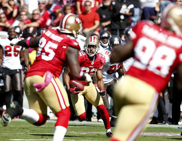 San Francisco 49ers Carlos Rogers intercepts a pass in the second quarter and makes the second touchdown against defeat Tampa Bay Buccaneers ,Sunday Oct. 9, 2011, at Candlestick PArk in San Francisco, Calif.  The 49ers defeated the Buccaneers 48 to 3. Photo: Lacy Atkins, The Chronicle