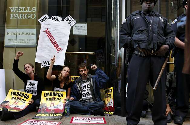 Protesters continued the Occupy Wall Street campaign as they blocked the entrances into the headquarters of Wells Fargo Bank in the financial district of San Francisco, Ca., on Wednesday October 12, 2011. Photo: Michael Macor, The Chronicle