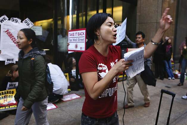 Shaw San Liu rallies the protesters as they continued the Occupy Wall Street campaign while many  blocked the entrances into the headquarters of Wells Fargo Bank in the financial district of San Francisco, Ca., on Wednesday October 12, 2011. Photo: Michael Macor, The Chronicle
