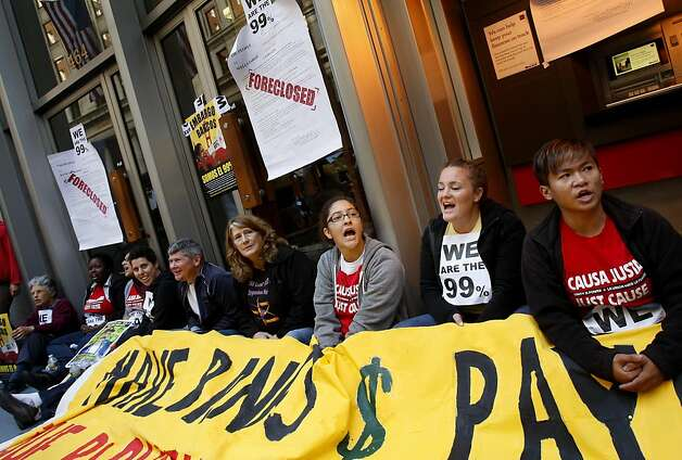 Protesters sat blocking the main entrance to Wells Fargo on California Street. Demonstrators from various groups including OccupySF blockaded the doors of the Wells Fargo corporate headquarters on California Street in San Francisco, Calif. Wednesday October 12, 2011. Photo: Brant Ward, The Chronicle