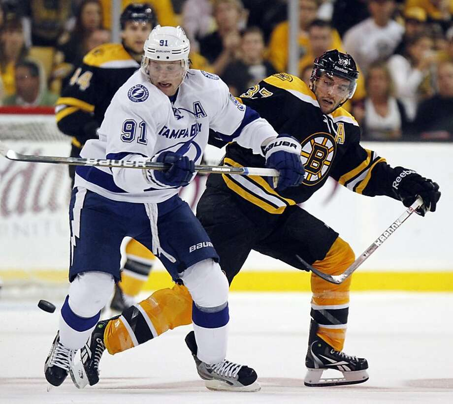 Tampa Bay Lightning's Steven Stamkos (91) battles Boston Bruins' Patrice Bergeron (37) for the puck in the second period of an NHL hockey game in Boston, Saturday, Oct. 8, 2011. (AP Photo/Michael Dwyer) Photo: Michael Dwyer, AP