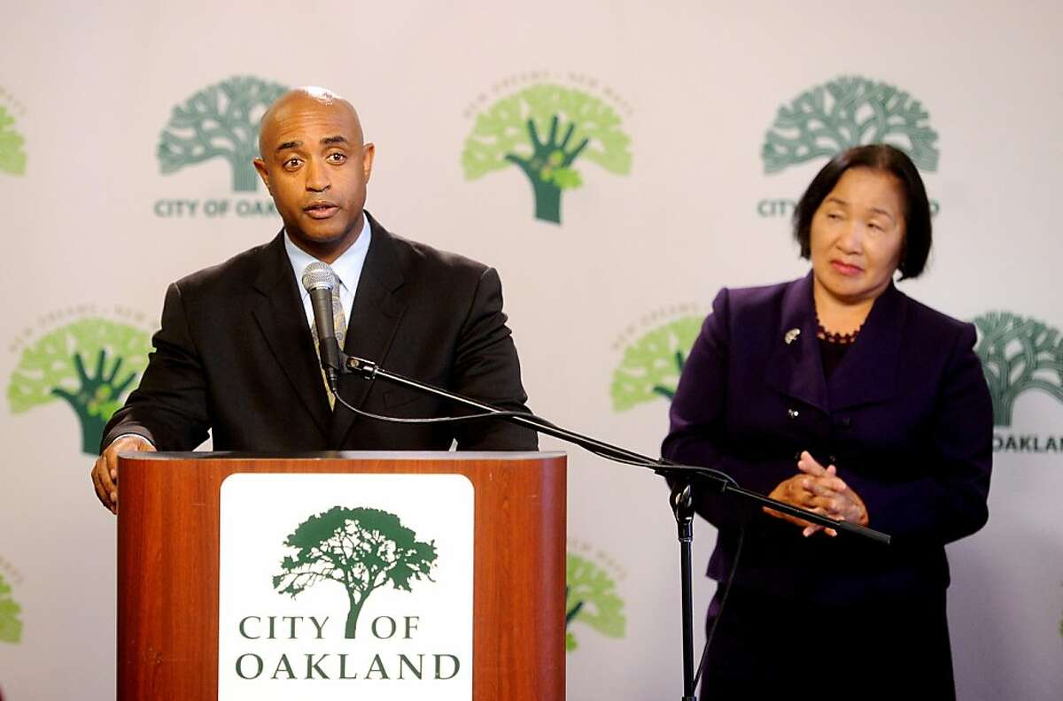 Outgoing Oakland Police Chief Anthony Batts speaks to reporters after announcing his resignation on Tuesday, Oct. 11, 2011, in Oakland, Calif. At right is Oakland Mayor Jean Quan.