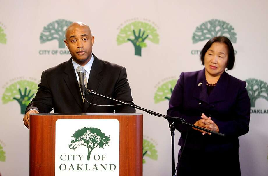 Outgoing Oakland Police Chief Anthony Batts speaks to reporters after announcing his resignation on Tuesday, Oct. 11, 2011, in Oakland, Calif. At right is Oakland Mayor Jean Quan. Photo: Noah Berger, Special To The Chronicle