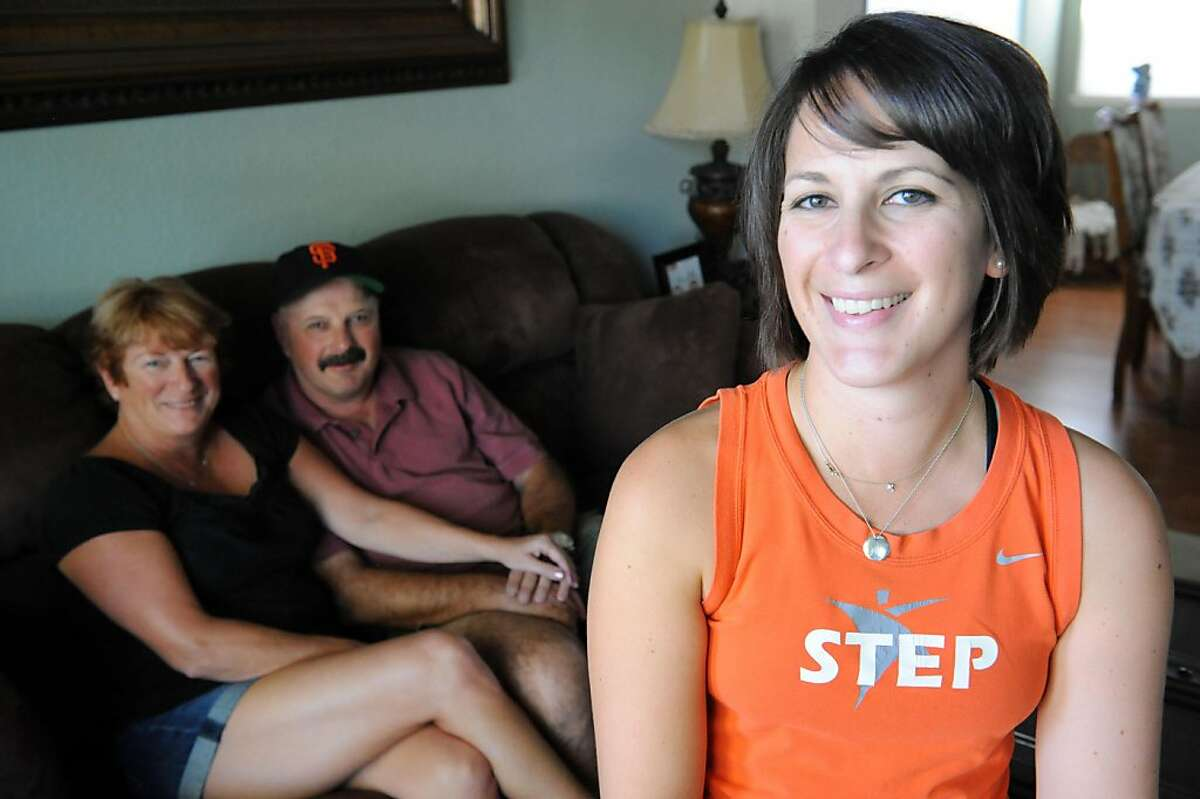 Mandy Durkin poses for a photo with her parents Tracy and Willie Towner in Fairfield on October 14, 2011. Durkin has temporarily moved back in with her parents.