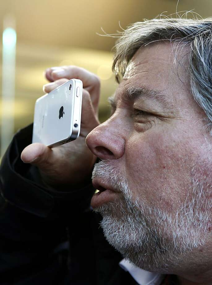 Apple Co-Founder Steve Wozniak examines the Apple's latest iPhone 4s he just purchased in front of the Apple Store in Los Gatos on October 14, 2011 in California. Stores worldwide were gripped Friday by the now familiar scene of gadget geeks scrambling for Apple's latest smartphone, the US giant's first new release since the death of co-founder Steve Jobs.     AFP Photo/Kimihiro Hoshino (Photo credit should read KIMIHIRO HOSHINO/AFP/Getty Images) Photo: Kimihiro Hoshino, AFP/Getty Images