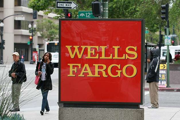 OAKLAND, CA - JULY 19:  A sign is posted in front of a Wells Fargo Bank branch on July 19, 2011 in Oakland, California.  San Francisco-based Wells Fargo & Co. reported a 30 percent surge in quarterly profits with earnings of $3.73 billion, or 70 cents per share compared to $2.88 billion, or 55 cents per share one year ago.  (Photo by Justin Sullivan/Getty Images)  Ran on: 07-24-2011 Wells Fargo reported a record $3.95 billion profit in the second quarter and plans to cut costs further by the end of the year. Photo: Justin Sullivan, Getty Images