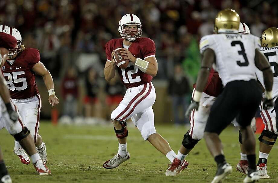 Stanford's Andrew Luck (12) looks to throw in the fourth quarter, as the Stanford Cardinal went on to beat the Colorado Bulldogs 48-7 at Stanford Stadium on Saturday October 8, 2011, in Palo Alto, Ca. Photo: Michael Macor, The Chronicle