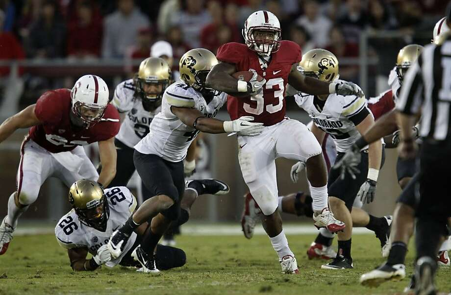 Stanford's Stepfan Taylor (33) breaks through on a first half run, as the Stanford Cardinal went on to beat the Colorado Bulldogs 48-7 at Stanford Stadium on Saturday October 8, 2011, in Palo Alto, Ca.   Ran on: 10-09-2011 Stanford's Stepfan Taylor (33) breaks through the Colorado defense on a first-half run. Taylor finished the day with 58 yards rushing, including a touchdown plunge in the first quarter. Photo: Michael Macor, The Chronicle
