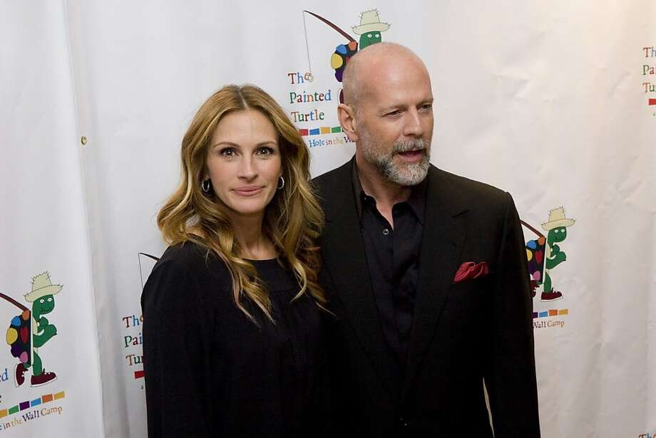 Julia Roberts and Bruce Willis pose for the media before a performance in support of The Painted Turtle, Paul Newman's Hole In the Wall California Camp, at Davies Symphony Hall in San Francisco, Calif., on Monday, October 27, 2008..  Ran on: 08-08-2010 Julia Roberts: People say she's a nice person. Photo: Laura Morton, Special To The Chronicle