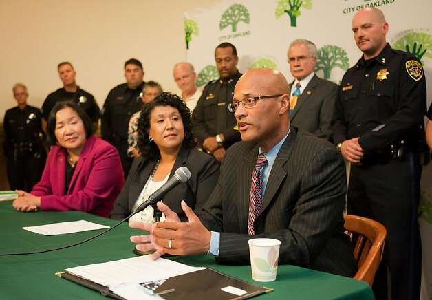 OAKLAND,CA---Oakland police Assistant Chief Howard Jordan, addresses the media shortly after he was sworn in as the interim police chief today in a ceremony at Oakland City Hall as Mayor Jean Quan,lf, and City Administrator Deanna Santana, look on. Chief Anthony Batts announced his resignation just two days ago. Jordan is a 23-year veteran of the force. Photo: Tomas Ovalle, Special To The Chronicle