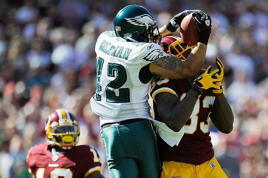 LANDOVER, MD - OCTOBER 16:  Kurt Coleman #42 of the Philadelphia Eagles intercepts a pass intended for Fred Davis #83 of the Washington Redskins during a game at FedExField on October 16, 2011 in Landover, Maryland.  (Photo by Patrick McDermott/Getty Images) Photo: Patrick McDermott, Getty Images
