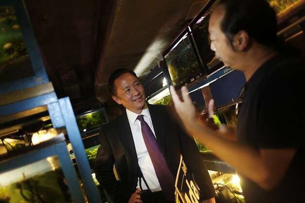 San Francisco Public Defender and San Francisco mayoral candidate Jeff Adachi (l to r) talks with Justin Hau, Ocean Aquarium owner, while on a merchant walk on Polk Street in  San Francisco, Calif., on Tuesday, September 20, 2011. Photo: Lea Suzuki, The Chronicle