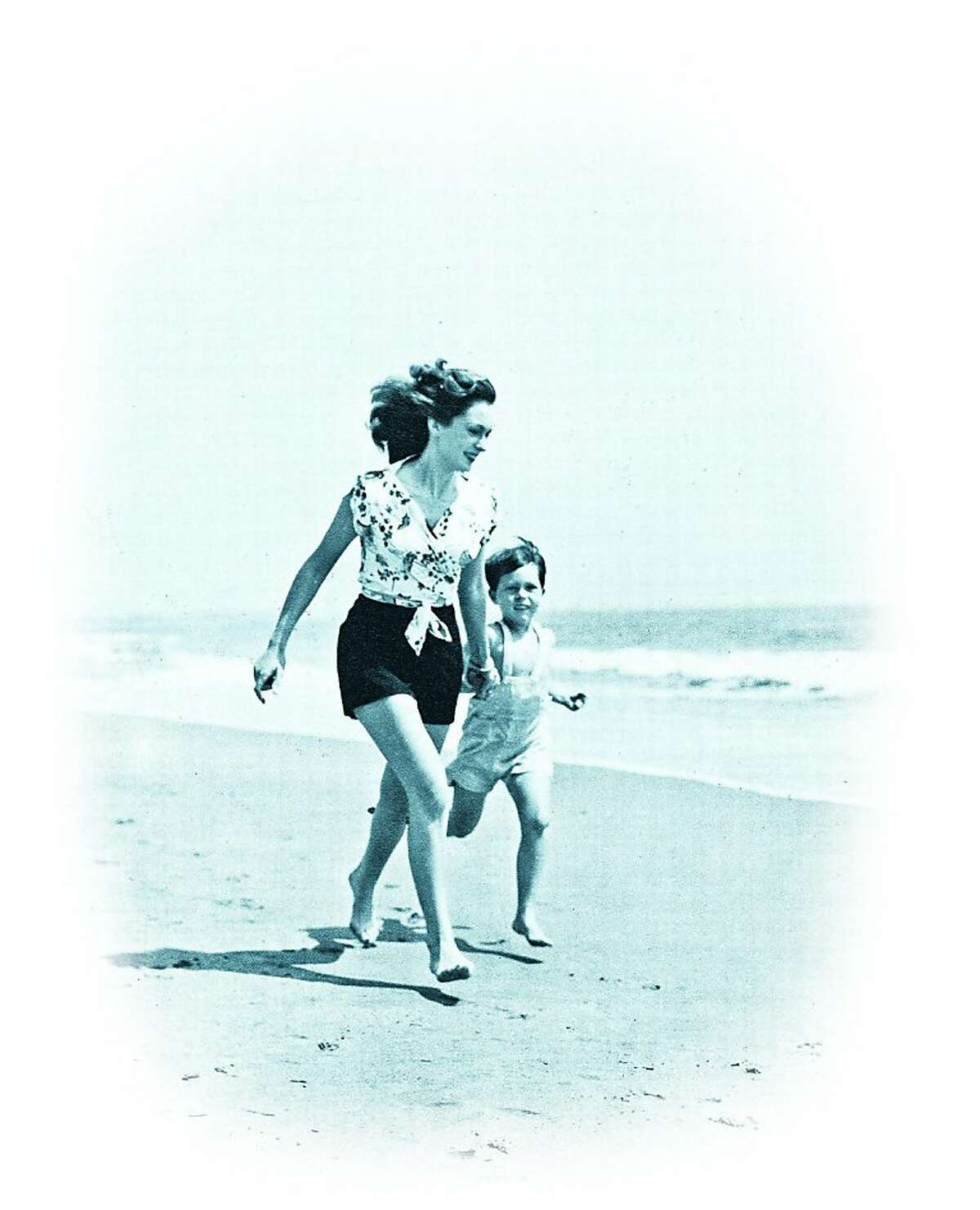 Michael Lindsay-Hogg as a child with his mother, Geraldine Fitzgerald, on the beach in Santa Monica