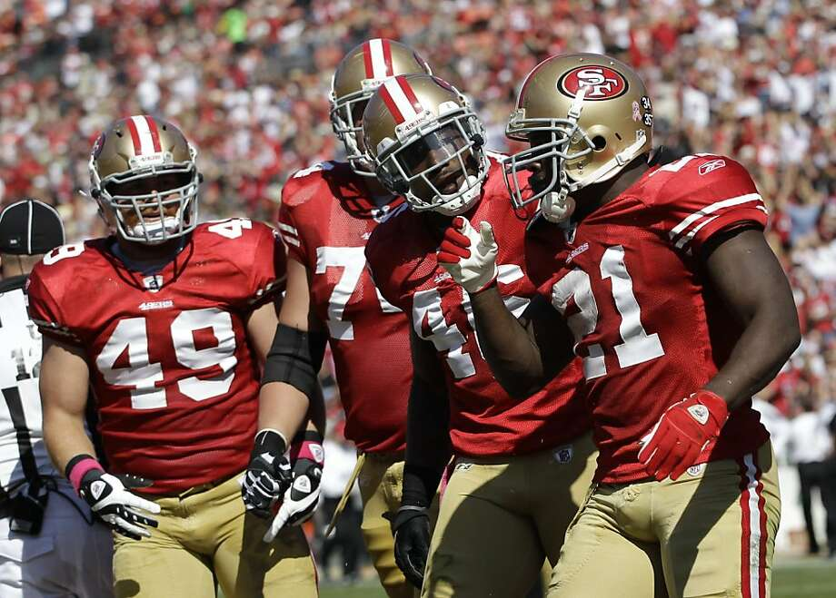 San Francisco 49ers running back Frank Gore, right, is greeted by his teammates after a touchdown during the second quarter of their NFL football game against the Tampa Bay Buccaneers in San Francisco, Sunday, Oct. 9, 2011. (AP Photo/Paul Sakuma) Photo: Paul Sakuma, AP