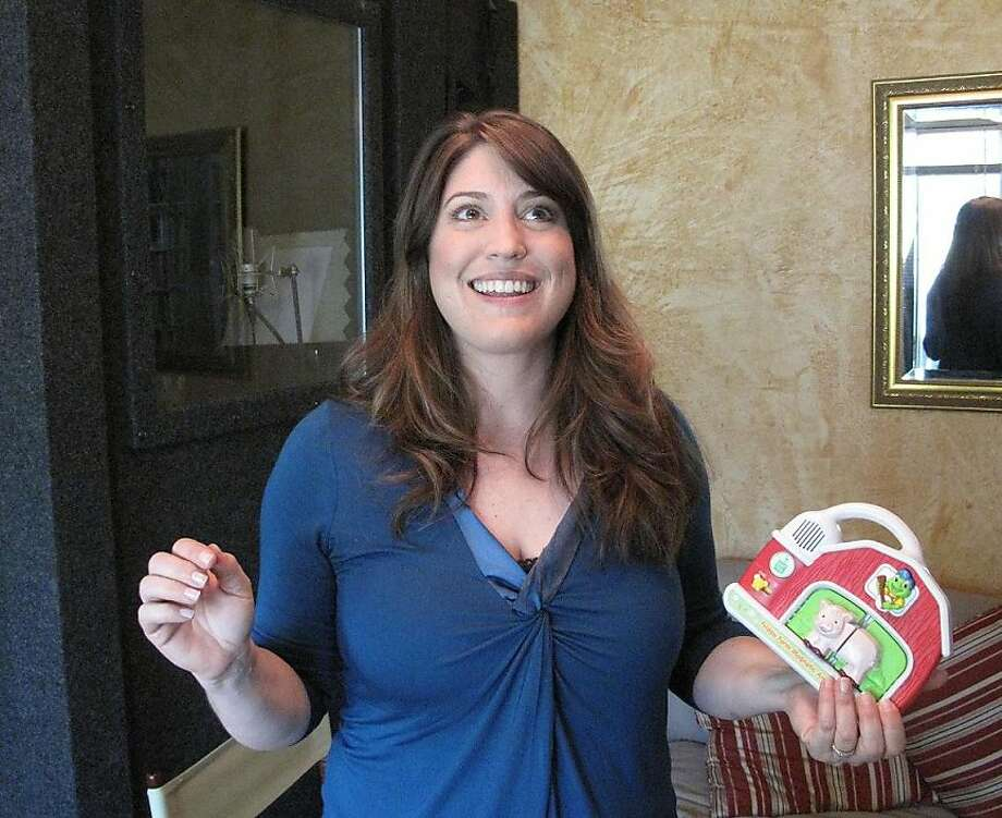 Amy Rubinate poses with the Fridge Farm Magnetic Animal Set, one of several toys, video games and other products she has provided dialogue for as a voice actress. Photo: Peter Hartlaub, The Chronicle