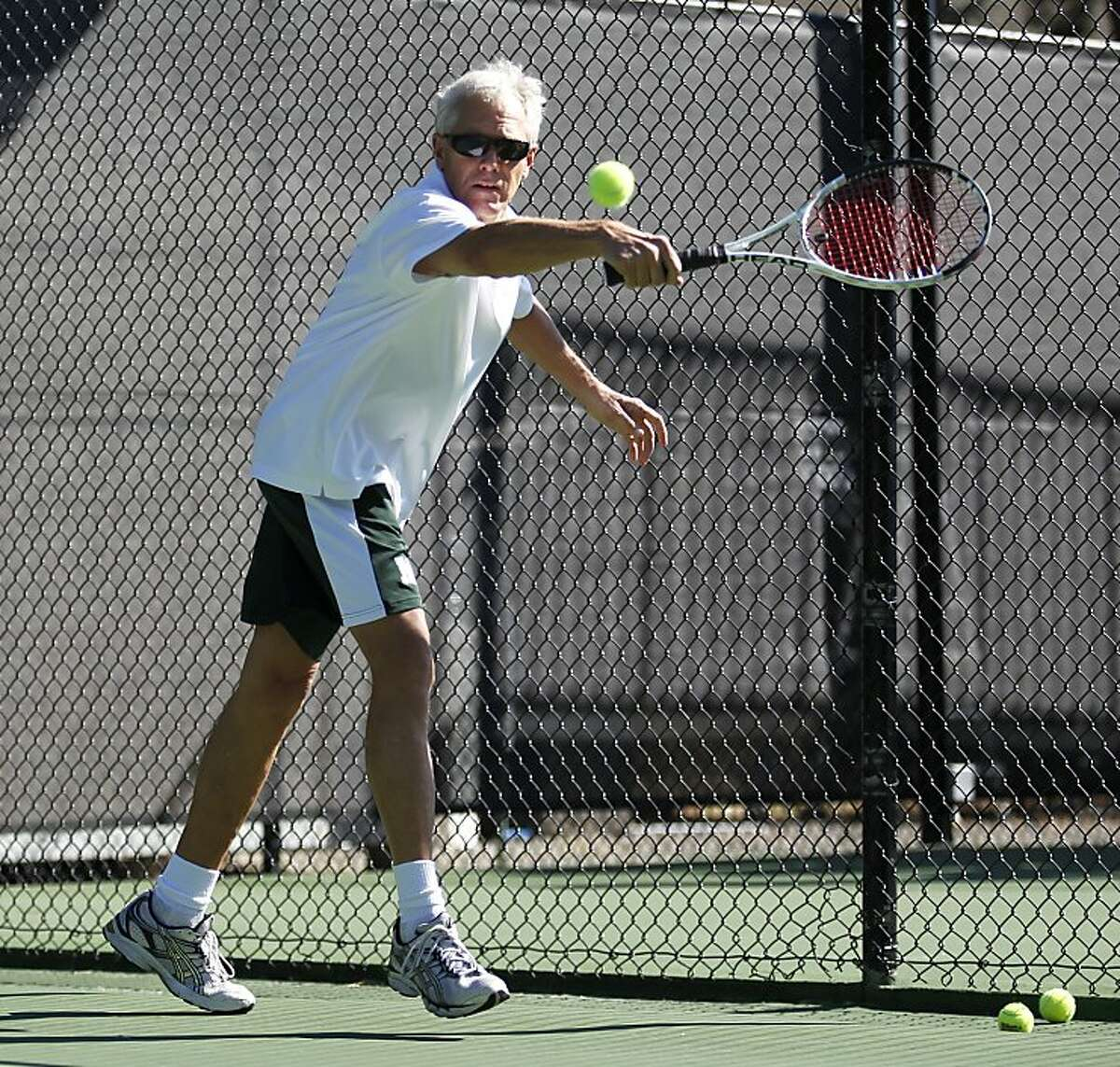 San Francisco Chronicle columnist Scott Ostler attempts to return a ball served by professional tennis player Ivo Karlovic on Thursday, October 13, 2011 at the Tiburon Peninsula Club in Tiburon, Calif. Ivo Karlovic serve is able to reach speeds of 150 miles per hour.