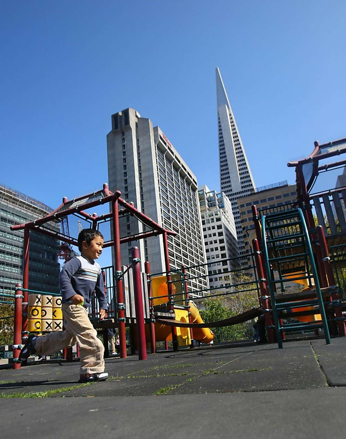 Residents of San Francisco enjoy the sunshine in Portsmouth Square, a popular park in Chinatown in San Francisco, Calif. on Friday, Sept. 30, 2011. The proposed Transbay development project will cast it's shadow across the Square.