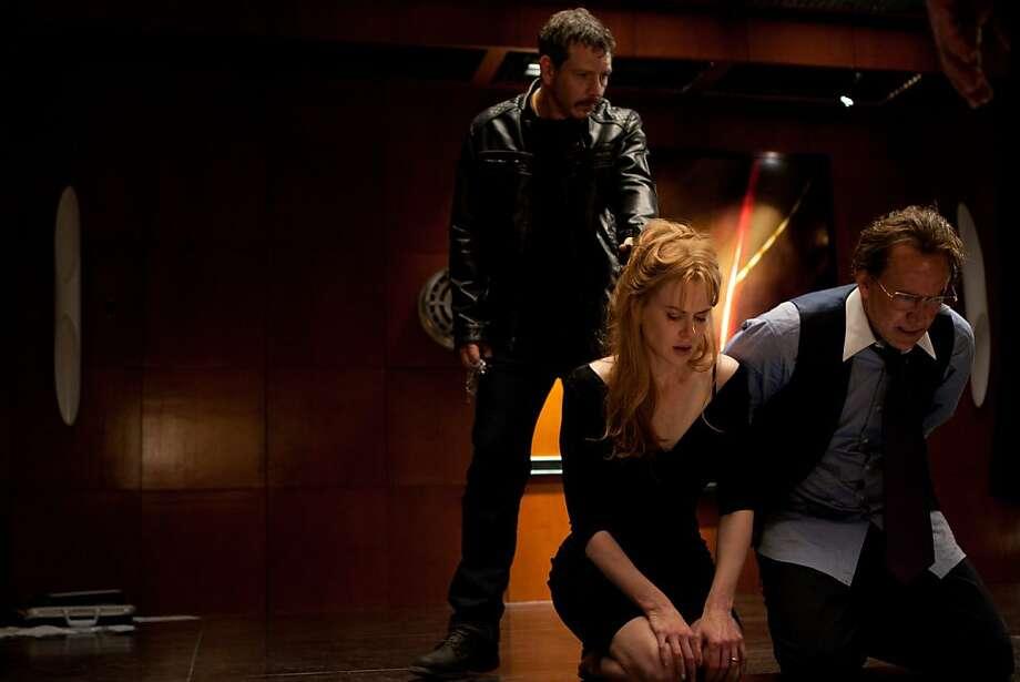 Ben Mendelsohn (Elias), Nicole Kidman (Sarah Miller) and Nicolas Cage (Kyle Miller) in TRESPASS. Photo: Alan Markfield, Millennium Entertainment