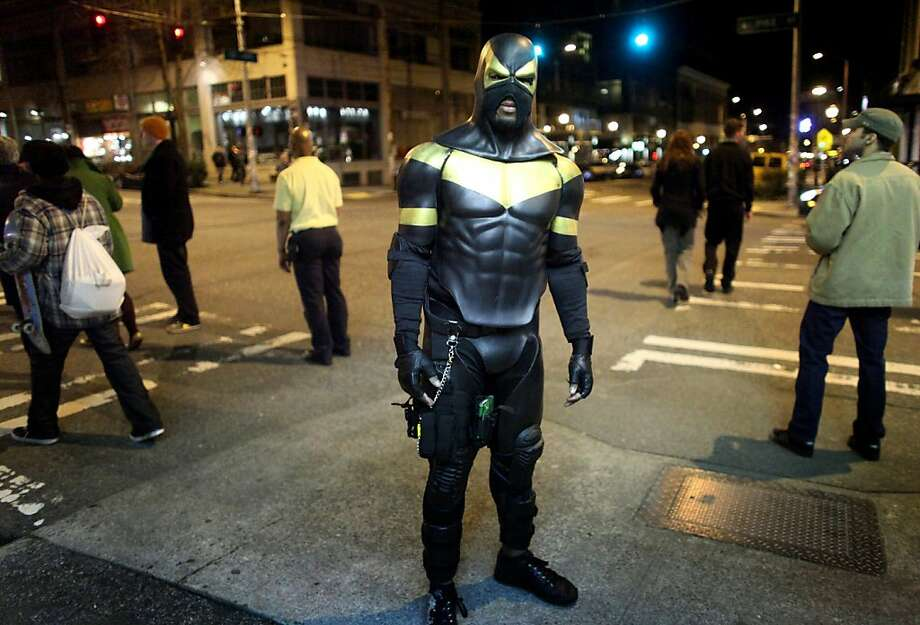 FILE - This Feb. 18, 2011 file photo shows Seattle superhero Phoenix Jones during a patrol of Seattle's Capitol Hill neighborhood. Jones, who has gained fans and a bit of fame as he works the streets of Seattle, was arrested early Sunday after he was accused of assaulting several people with pepper spray. He was booked in county jail on four counts of assault, with arraignment set for Thursday, police said Monday. Jones says he was only trying to stop a street brawl. (AP Photo/seattlepi.com, Joshua Trujillo, File) Photo: Joshua Trujillo, AP